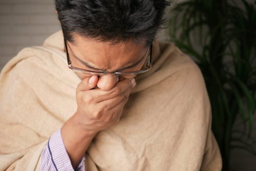 Home remedies for cough- A man Coughing